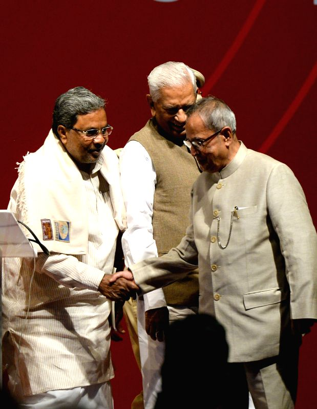 President Pranab Mukherjee with Karnataka Chief Minister Siddaramiah at the launch of Mobile One - the e-governance project in Karnataka, in Bengaluru, on Dec 8, 2014. - Siddaramiah and Pranab Mukherjee