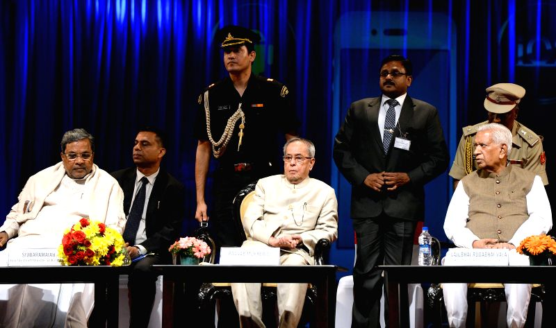 President Pranab Mukherjee with Karnataka Chief Minister Siddaramiah and Karnataka Governor Vajubhai Rudabhai Vala at the launch of Mobile One - the e-governance project in Karnataka, in .. - Siddaramiah and Pranab Mukherjee