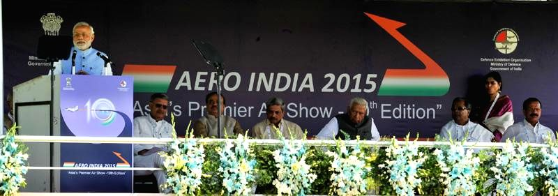 Prime Minister Narendra Modi addresses at the Aero India-2015 Air Show​ organised​ at Yelahanka Air-force Station, in Bengaluru on Feb 18, 2015. Also seen Union Defence Minister ... - Narendra Modi