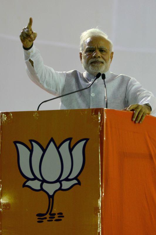 Prime Minister Narendra Modi addresses during a public meeting in Bengaluru, on April 3, 2015. - Narendra Modi