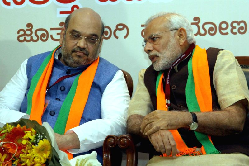 Prime Minister Narendra Modi and BJP chief Amit Shah during BJP National Executive Committee meeting in Bengaluru on April 2, 2015. - Narendra Modi and Amit Shah