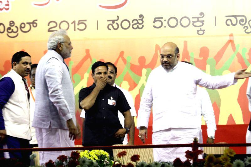 Prime Minister Narendra Modi, BJP chief Amit Shah and Karnataka BJP chief Prahalad Joshi during a public meeting in Bengaluru, on April 3, 2015. - Narendra Modi, Amit Shah and Prahalad Joshi