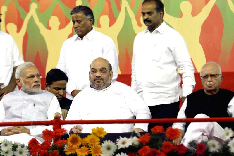 Prime Minister Narendra Modi, BJP chief Amit Shah and BJP veteran L K Advani during a public meeting in Bengaluru, on April 3, 2015. - Narendra Modi, Amit Shah and L K Advani