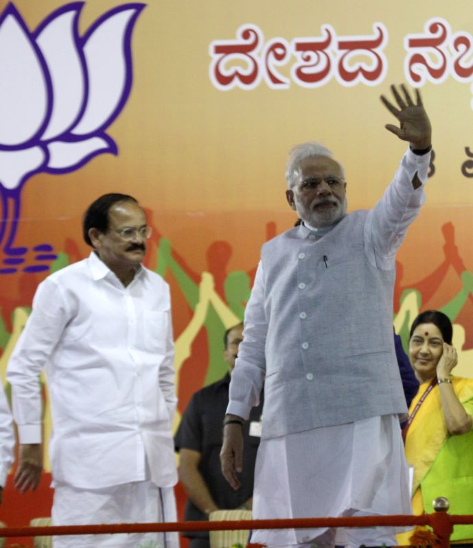 Prime Minister Narendra Modi during a public meeting in Bengaluru, on April 3, 2015. Also seen Union Minister for Urban Development, Housing and Urban Poverty Alleviation and Parliamentary ... - Narendra Modi, M. Venkaiah Naidu and Sushma Swaraj