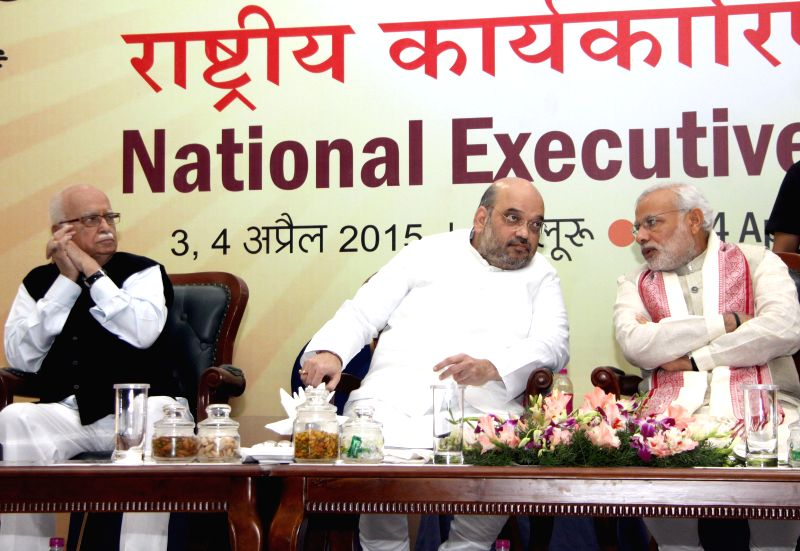 Prime Minister Narendra Modi with BJP veteran L K Advani, party chief Amit Shah during the BJP National Executive Committee meeting in Bengaluru, on April 3, 2015. - Narendra Modi, L K Advani and Amit Shah