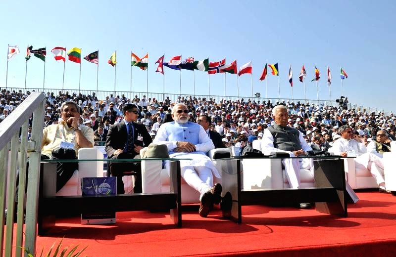 Prime Minister Narendra Modi with Union Defence Minister​​ Manohar Parrikar and Karnataka Governor Vajubhai Rudabhai Vala at the Aero India-2015 Air Show, at Yelahanka Air-force ... - Narendra Modi