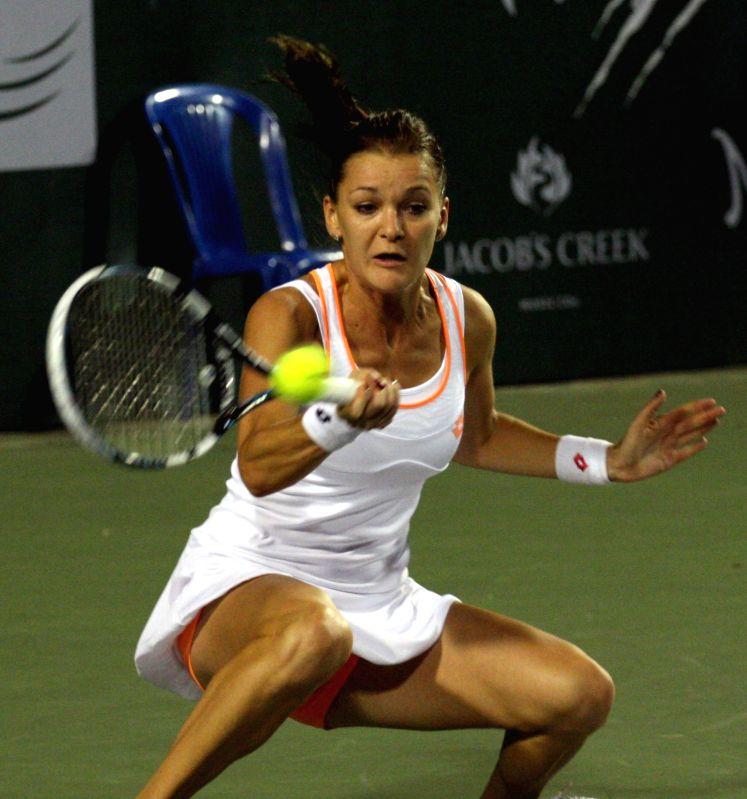 Pune Marathas` Agnieszka Radwanska in action during their women`s singles match of Champions Tennis League against Bangalore Raptors` Venus Williams at KSLTA, in Bengaluru on Nov. 20, ...