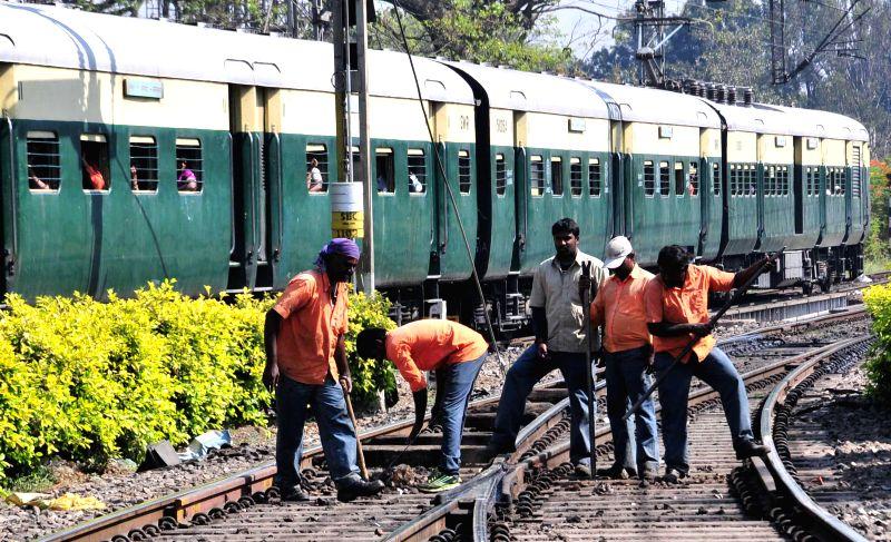 Railway staffs busy with their work in Bengaluru on Feb 26, 2015. The Union Railways Minister Suresh Prabhakar Prabhu Thursday presented the Railway Budget 2015-16 at the Parliament. - Suresh Prabhakar Prabhu Thursday