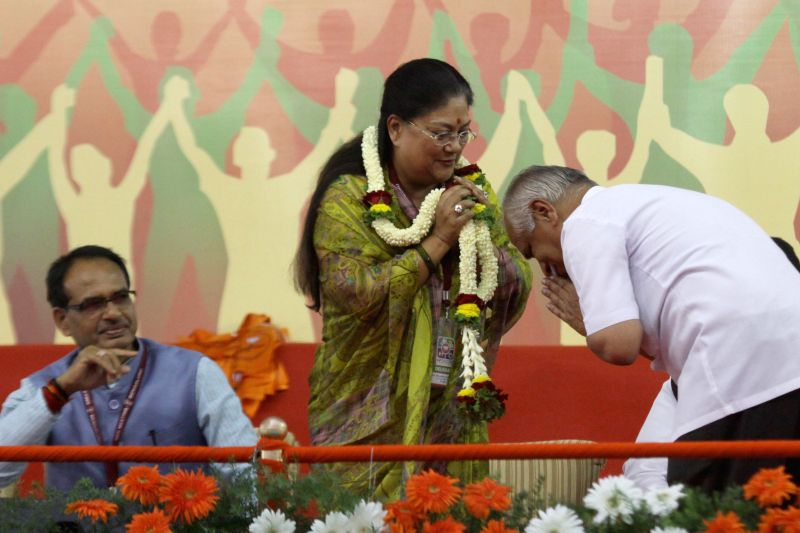 Rajasthan Chief Minister Vasundhara Raje during a public meeting in Bengaluru, on April 3, 2015. Also seen Madhya Pradesh Chief Minister Shivraj Singh Chouhan - Vasundhara Raje and Shivraj Singh Chouhan