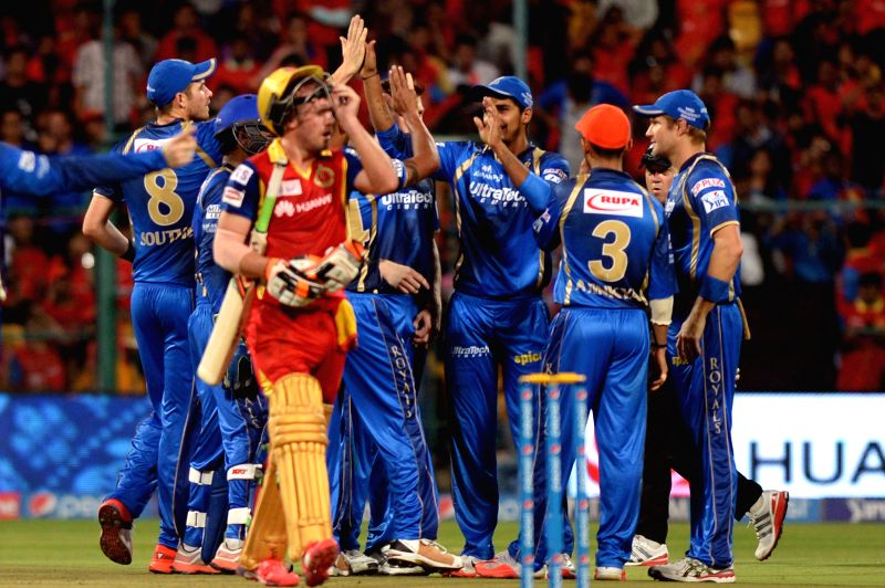 Rajasthan Royals celebrate fall of AB de Villiers' wicket during an IPL-2015 match between Royal Challengers Bangalore and Rajasthan Royals at M Chinnaswamy Stadium in Bangaluru on April ...