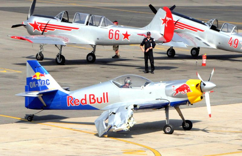 Redbull aeroplanes being attended on ground after two of them they came dangerously close damaging their wings during an aerobatic performance at Yelahanka Air-force Station, in Bengaluru ...