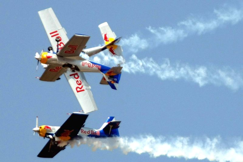 Redbull aircraft flies in Bengaluru skies during the rehearsal for the Aero India show 2015 at Yelhanaka Airforce Station on Feb 17, 2015.