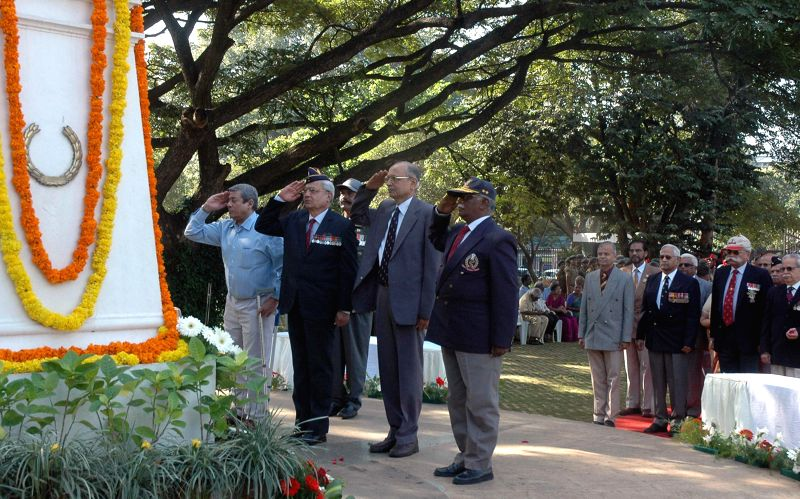 Retired army officers pay tribute to the martyrs of 1971 war on Vijay Diwas at the National Military Memorial, in Bengaluru on Dec 16, 2014.