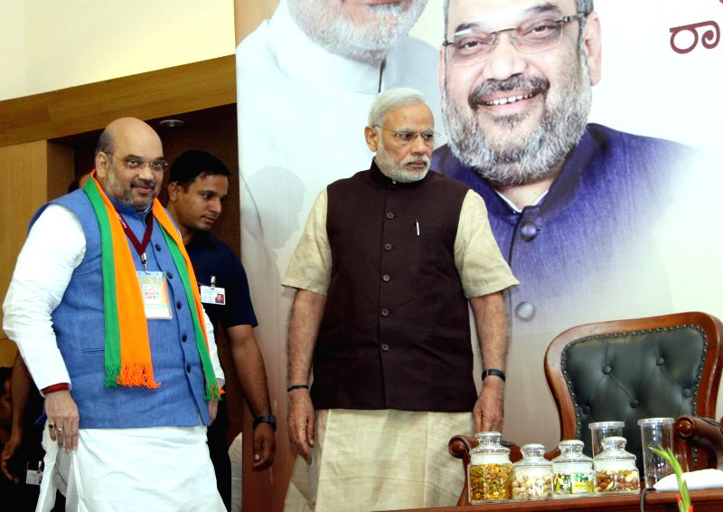 rime Minister Narendra Modi and BJP chief Amit Shah during BJP National Executive Committee meeting in Bengaluru on April 2, 2015. - Narendra Modi and Amit Shah
