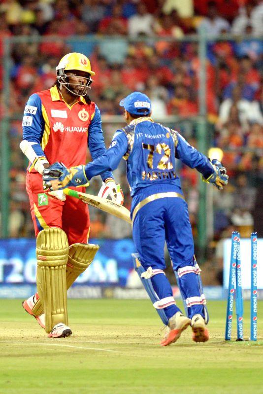 Royal Challengers Bangalore  batsman Chris Gayle during an IPL-2015 match between Royal Challengers Bangalore and Mumbai Indians at M Chinnaswamy Stadium, in Bengaluru, on April 19, 2015. - Chris Gayle