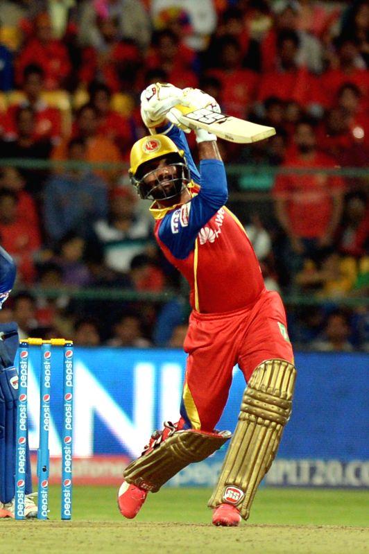 Royal Challengers Bangalore batsman Dinesh Karthik in action during an IPL-2015 match between Royal Challengers Bangalore and Rajasthan Royals at M Chinnaswamy Stadium in Bangaluru on ... - Dinesh Karthik
