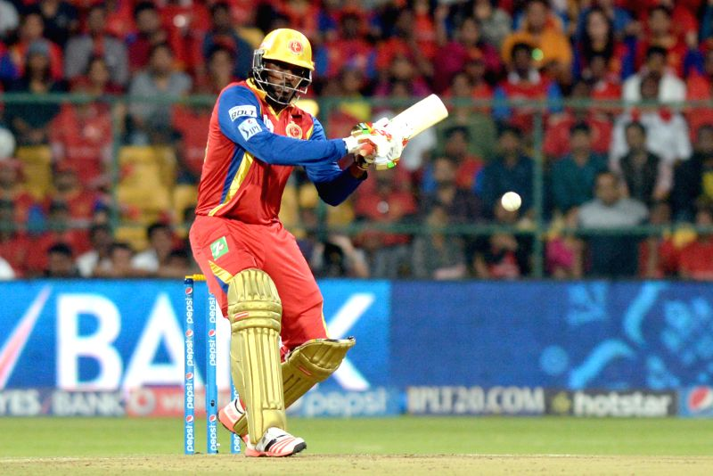 Royal Challengers Bangalore batsman Chris Gayle in action during an IPL-2015 match between Royal Challengers Bangalore and Kolkata Knight Riders at M Chinnaswamy Stadium in Bangaluru on ... - Chris Gayle