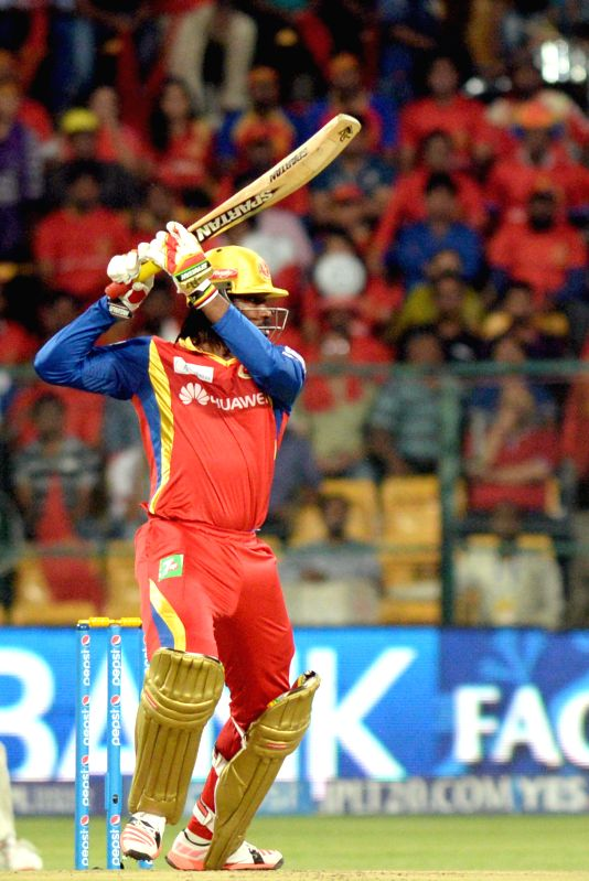 Royal Challengers Bangalore batsman Chris Gayle in action during an IPL-2015 match between Royal Challengers Bangalore and Kings XI Punjab at M. Chinnaswamy Stadium in Bengaluru on May 6, ... - Chris Gayle