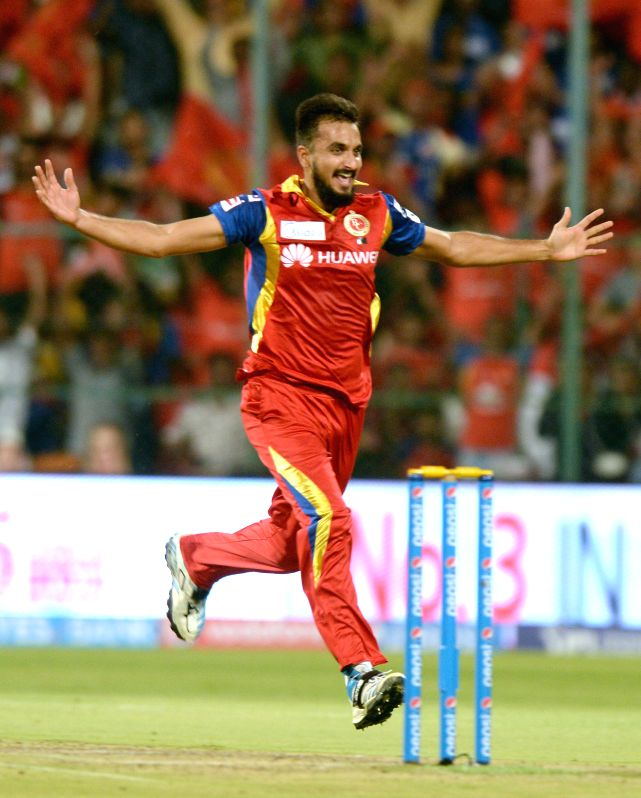Bengaluru : Royal Challengers Bangalore bowler Harshal Patel celebrates fall of a Chennai Super Kings batsman Dwayne Smith wicket during an IPL-2015 match between Royal Challengers Bangalore and ... - Harshal Patel