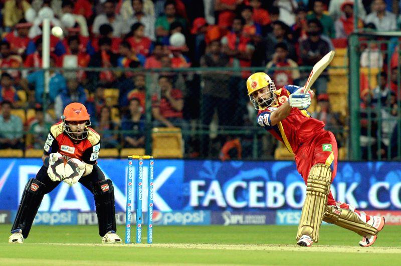 Royal Challengers Bangalore captain Virat Kohli in action during an IPL-2015 match between Royal Challengers Bangalore and Sunrisers Hyderabad at M Chinnaswamy Stadium, in Bengaluru, on ... - Virat Kohli