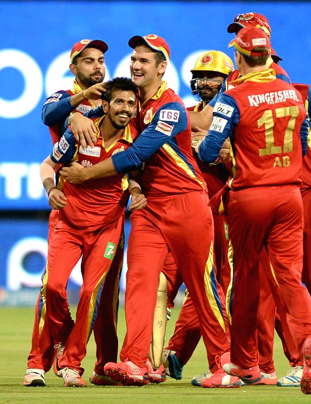Royal Challengers Bangalore celebrate fall of a wicket during an IPL-2015 match between Royal Challengers Bangalore and Chennai Super Kings at M Chinnaswamy Stadium, in Bengaluru, on April ...