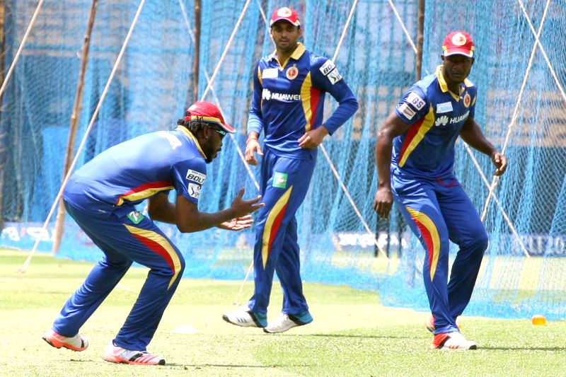 Royal Challengers Bangalore players Chris Gayle and Darren Sammy during a practice session at M Chinnaswamy Stadium, in Bengaluru, on May 1, 2015.
