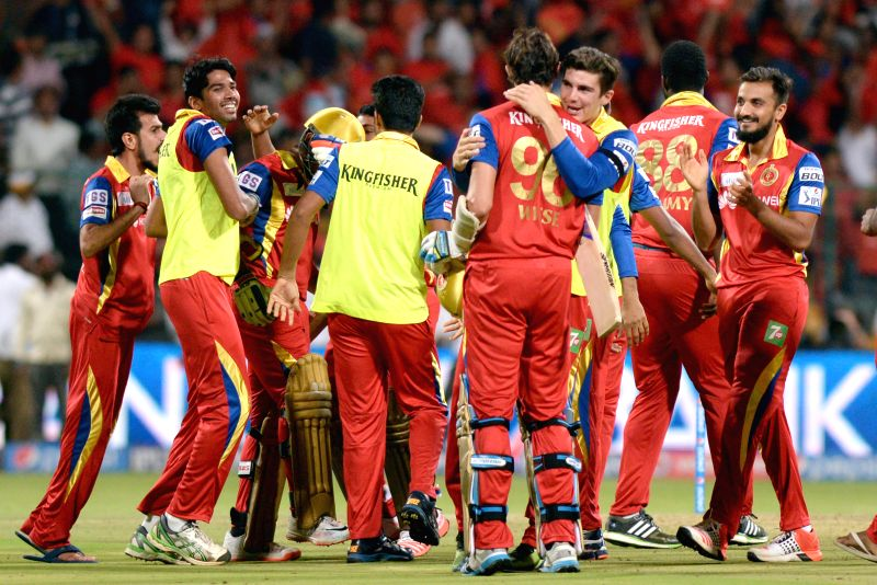 Royal Challengers Bangalore players celebrate their win over Kolkata Knight Riders during an IPL-2015 match between Royal Challengers Bangalore and Kolkata Knight Riders at M Chinnaswamy ...