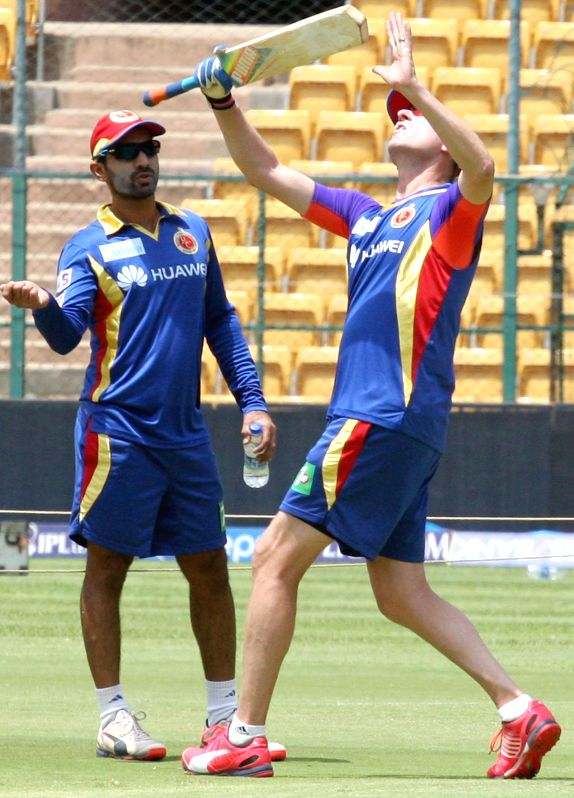 Royal Challengers Bangalore (RCB) bowling coach Allan Donald with RCB player Dinesh Karthik during a practice session at M Chinnaswamy Stadium, in Bengaluru, on May 1, 2015.