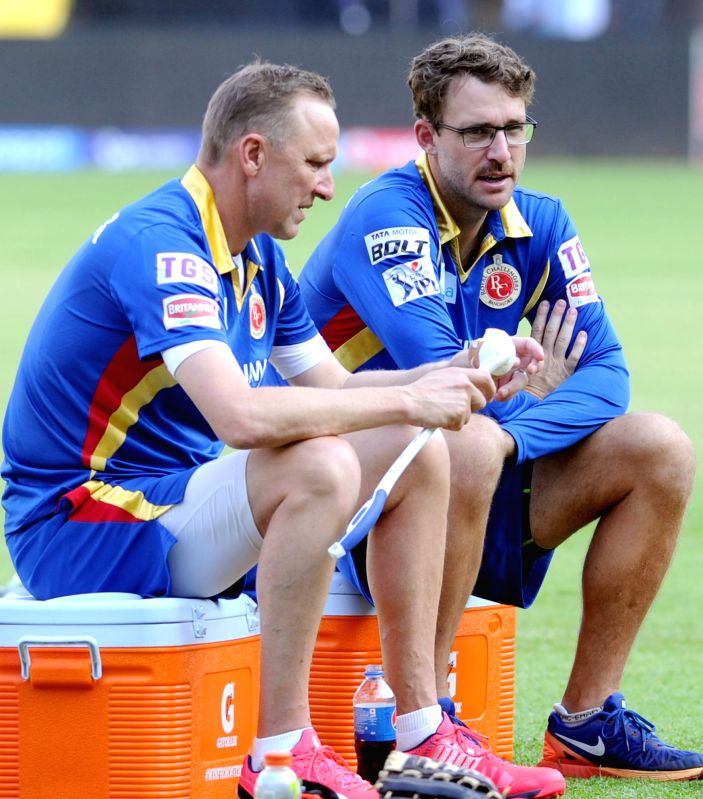 Royal Challengers Bangalore (RCB) coach Daniel Vettori and bowling coach Allan Donald during a practice session at M Chinnaswamy Stadium, in Bengaluru, on May 1, 2015.