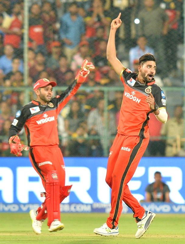 Bengaluru: Royal Challengers Bangalore's Mohammed Siraj and Parthiv Patel appeal during the seventh IPL 2019 match between Royal Challengers Bangalore and Mumbai Indians at M Chinnaswamy Stadium in Bengaluru on March 28, 2019.