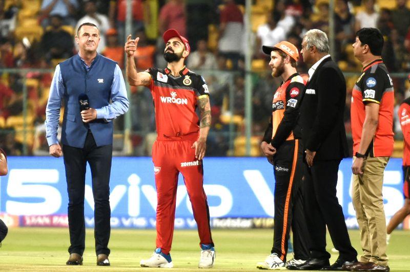 Bengaluru: Royal Challengers Bangalore's Virat Kohli and Sunrisers Hyderabad's Kane Williamson during the toss ahead of the 54th match of IPL 2019 at M.Chinnaswamy Stadium in Bengaluru on May 4, 2019. (Photo: IANS)
