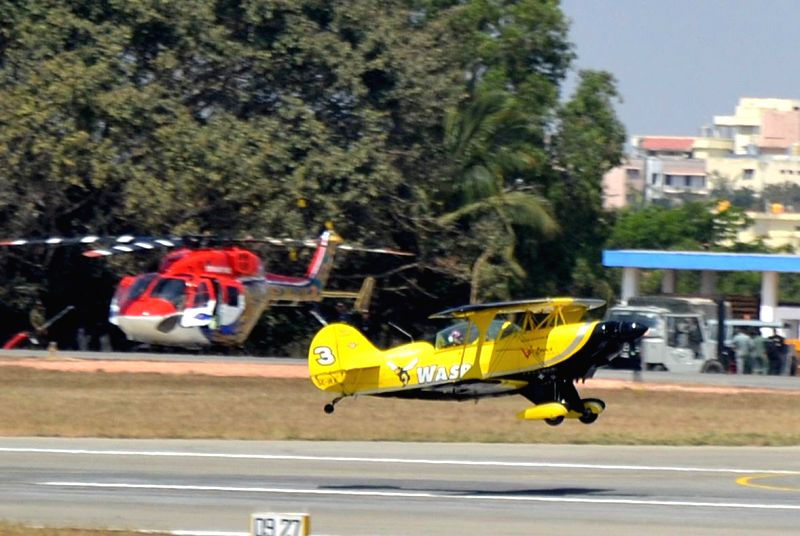 Scandinavian wasp aircraft flies during the rehearsal for the Aero India show 2015 at Yelhanaka Airforce Station, in Bengaluru on Feb 14, 2015.