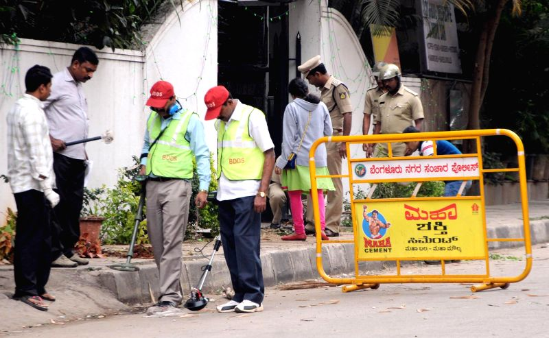 Security personnel carry out investigations at the site of Dec 28 low intensity blast that rocked Bengaluru's Church street, on Dec 29, 2014.