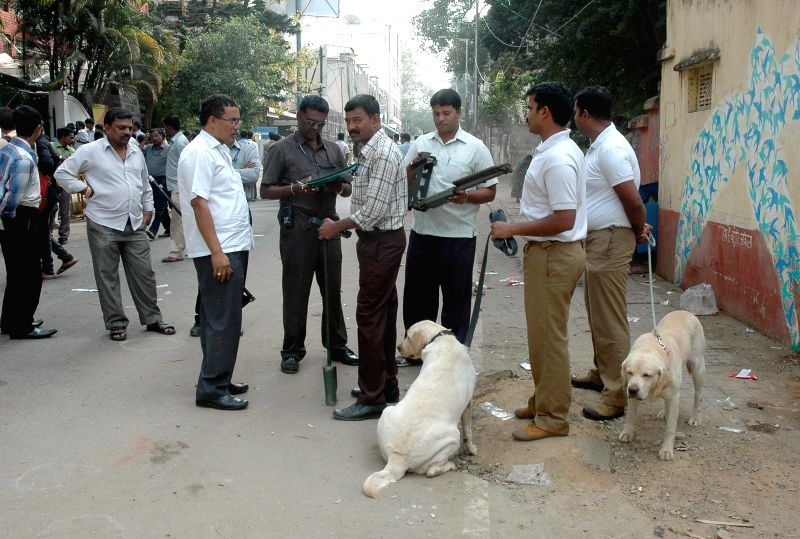 Security personnel carry out investigations at the site of Dec 28 Church street blasts in Bengaluru, on Dec 30, 2014. The traffic was restored on the road.