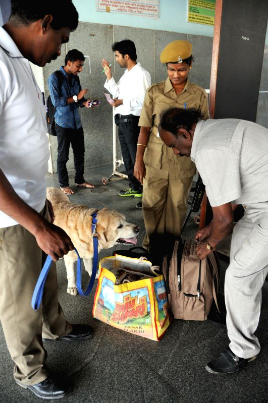 Security personnel check passengers' luggage at KSRTC Bus Stand, in the wake of Dec 28 Church street bomb blast, in Bengaluru, on Dec 29, 2014.