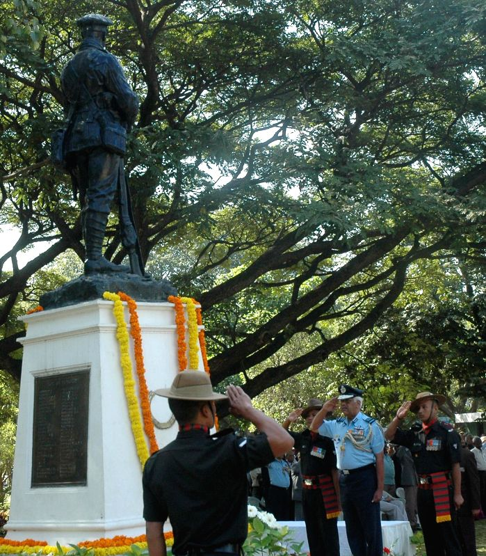 Senior Air Staff Officer IAF Training Command, Air Marshal S.R.K. Nair pays tribute to the martyrs of 1971 ar on Vijay Diwas at the National Military Memorial, in Bengaluru on Dec 16, ...