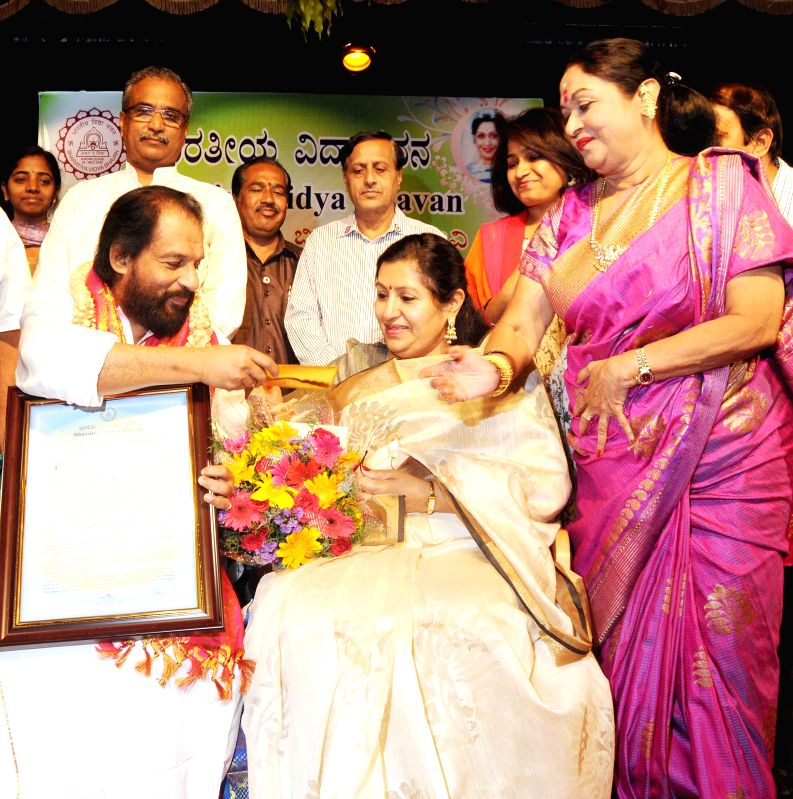 Singer KJ Yesudas with wife Prabha Yesudas, during a `B Saroja Devi` award presentation programme organised by Bharatiya Vidya Bhavan, in Bengaluru on April 11, 2015.