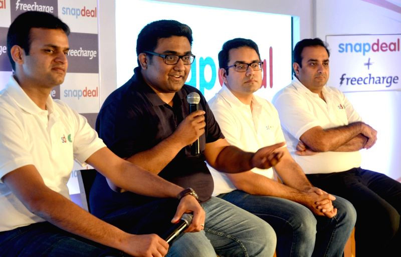 Snapdeal co-founder Rohit Bansal, FreeCharge Co-Founder and CEO Kunal Shah and others during a programme in Bengaluru, on April 8, 2015. Snapdeal has acquired FreeCharge. - Kunal Shah