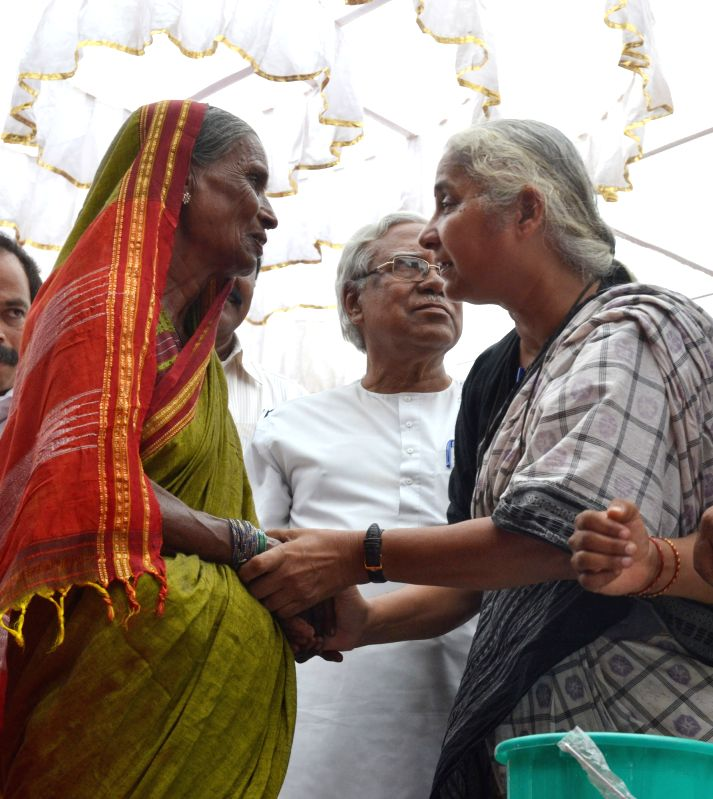 Social activist Medha Patkar interacts with a woman during the inauguration of a farmers' rally against the land acquisition ordinance in Bengaluru on April 28, 2015.