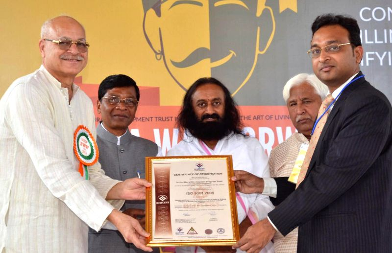 Spiritual leader Sri Sri Ravi Shankar being felicitated by Chhattisgarh Government in Bengaluru, on Jan 16, 2015.