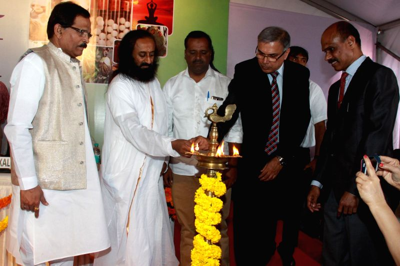 Spiritual leader Sri Sri Ravi Shankar, the Union Minister of State for AAYUSH (Independent Charge) and Health and Family Welfare, Shripad Yesso Naik, Karnataka Health and Family welfare ...