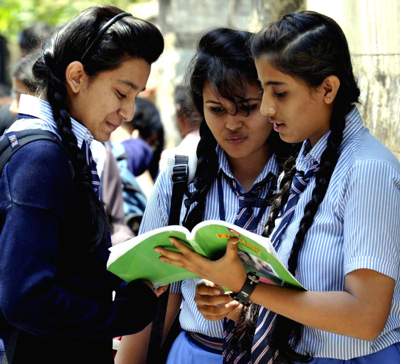 Students carry out last minute revision ahead of Board examinations in Bengaluru on March 30, 2015.