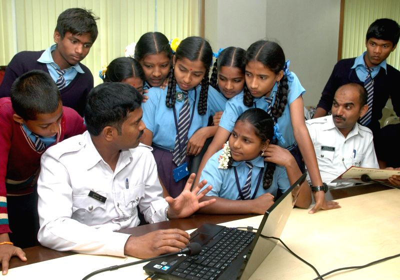 Students of CMCA interact with policemen during the 10th Traffic Police Day 2014 at Traffic Management Centre, in Bengaluru on Dec 23, 2014.