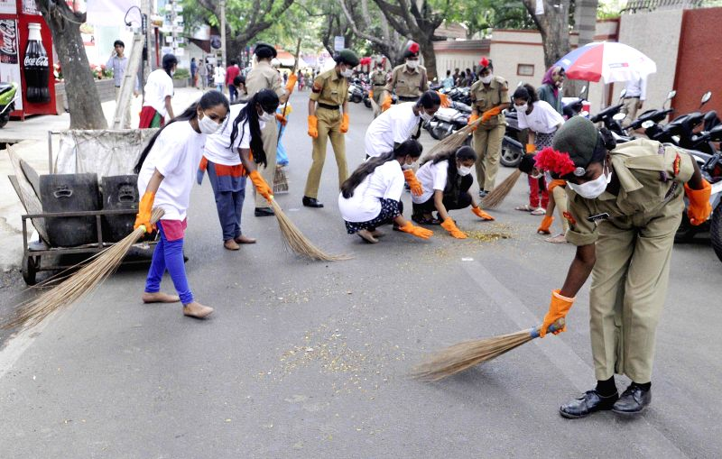 Students, residents and BBMP workers participate in Swaccha Koramangla campaign organised by Namma Bengaluru Foundation, in Bengaluru on Dec 11, 2014.