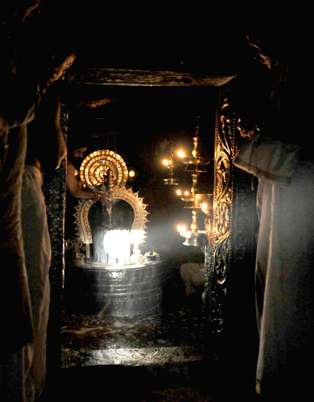 Sun rays fall on Shiva linga on Makara Sankranti at Gavi Gangadhareshwara Temple which was cut out of a monolithic rock probably in the 9th century in Bengaluru on Jan.14, 2015.