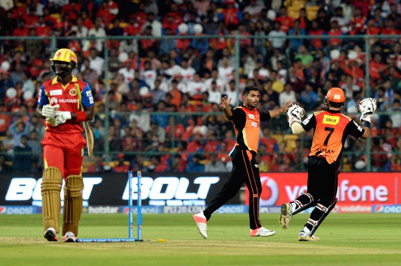 Sunrisers Hyderabad celebrate fall of a wicket during an IPL-2015 match between Royal Challengers Bangalore and Sunrisers Hyderabad at M Chinnaswamy Stadium, in Bengaluru, on April 13, ...
