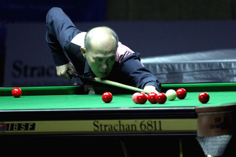 Thai player Chuchart Trairattanapradit in action during IBSF World Snooker Championships at Kanteerava Stadium, in Bengaluru on Nov. 28, 2014.