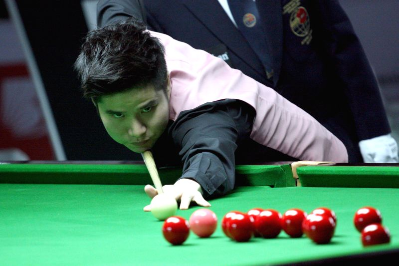 Thai player Kritsanut Lertsattayathorn in action during IBSF World Snooker Championships at Kanteerava Stadium, in Bengaluru on Nov. 27, 2014.