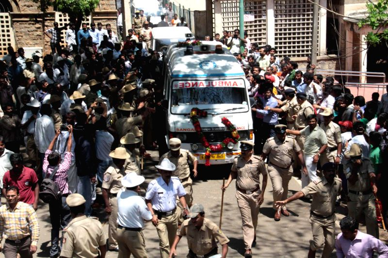 The body of Bangalore Additional Commissioner of Commercial Taxes D K Ravi, who was found dead in his apartment under mysterious circumstances, being taken away after postmortem in ...
