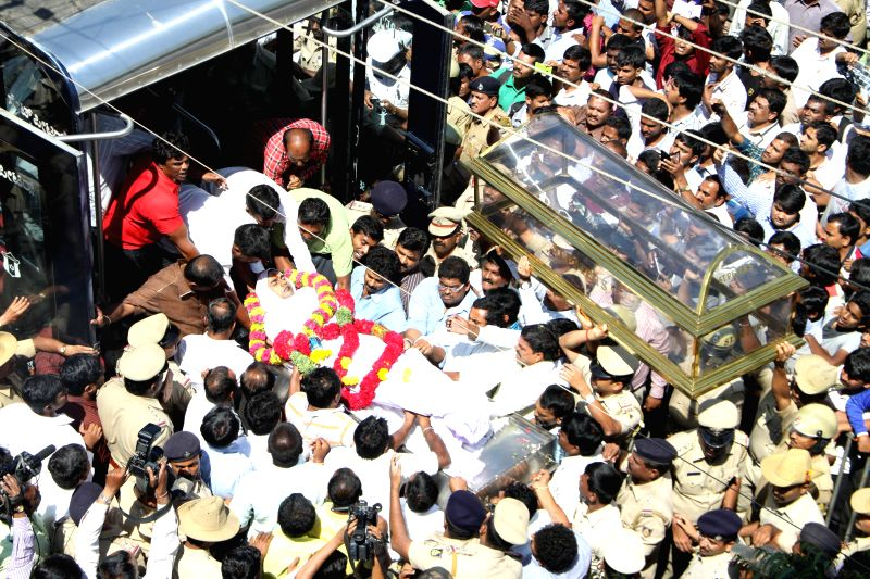 The body of Bangalore Additional Commissioner of Commercial Taxes D K Ravi, who was found dead in his apartment under mysterious circumstances, being taken away for last rite, in Bengaluru ...